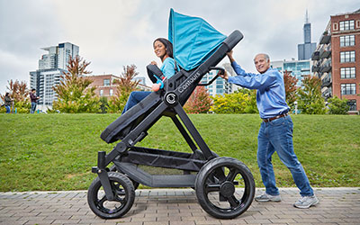 Adults try worlds largest pram