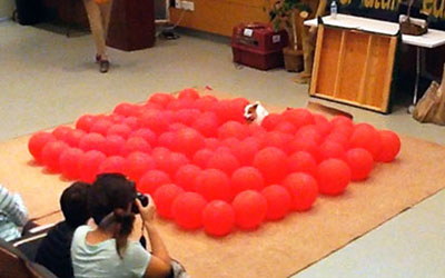 Fastest time to pop 100 balloons by a dog