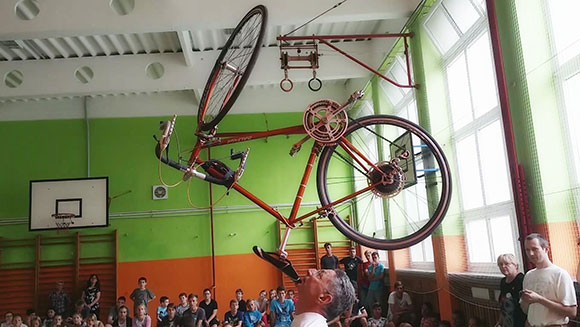 Longest duration balancing a bicycle on the chin header
