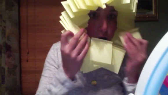 Most sticky notes attached to the face in one minute