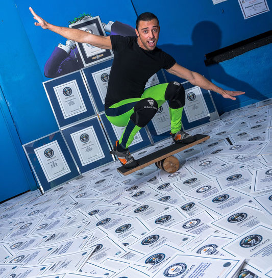 Silvio-Sabba-with-all-of-his-Guinness-World-Records-certificates.jpg